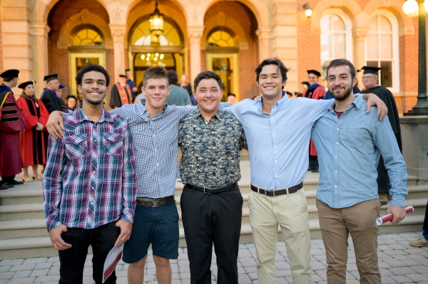 male students in front of Old Main