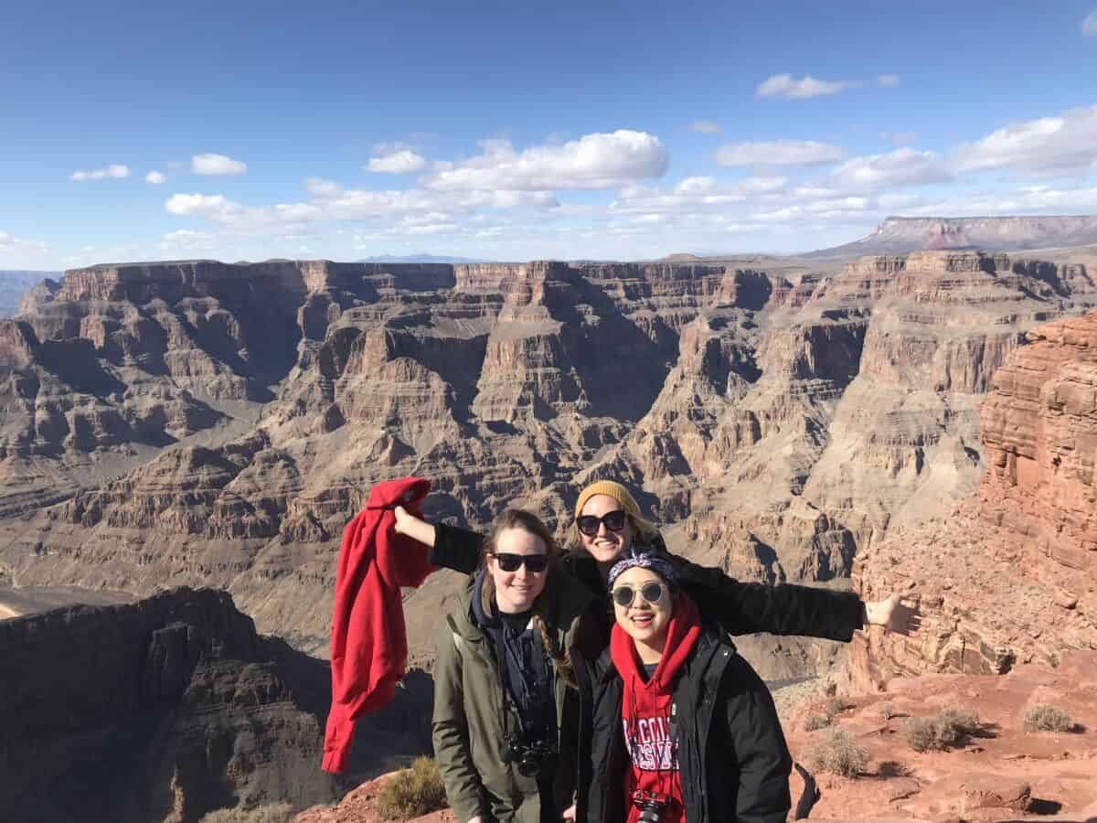 Three W&J students pose at the Grand Canyon during a spring break trip.