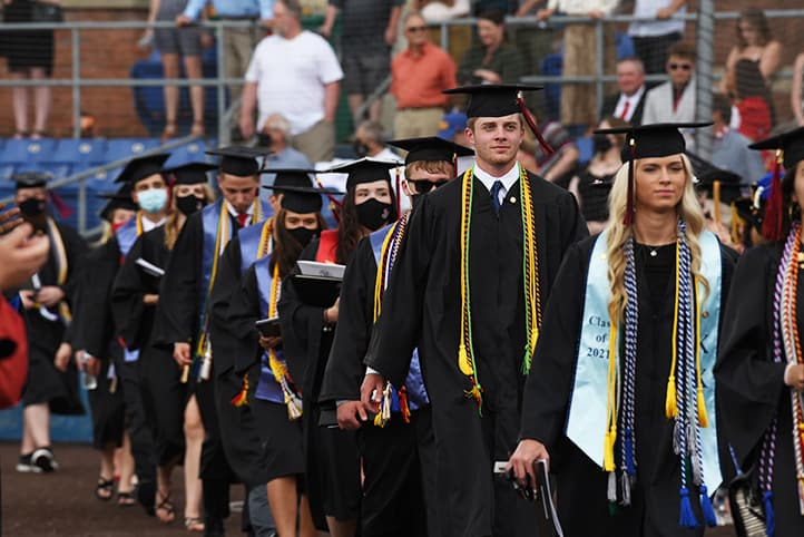 Students walking into the graduation ceremony.