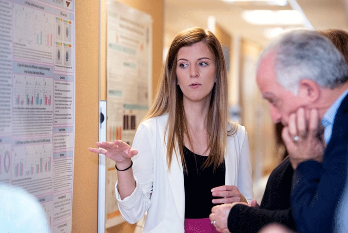 Elisa Yazdani presents her work at a poster session.