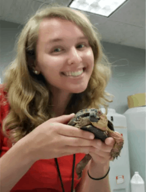 Holly Troesch holding a turtle