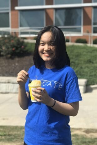 Linh Hoang Tu Khuat eating ice cream at orientation