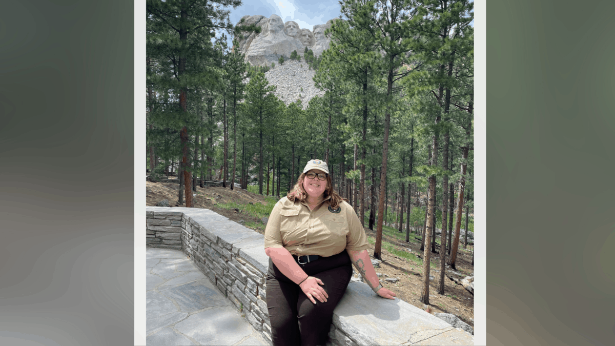 Sarah Byrne poses in front of Mount Rushmore.