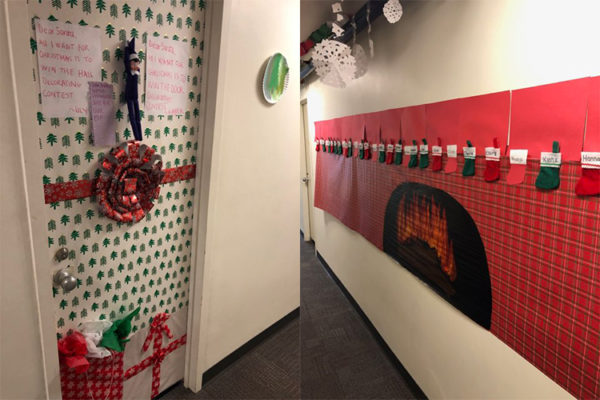 Students decorated one door to look like a wrapped present and made a faux fireplace out of construction paper in another hall.