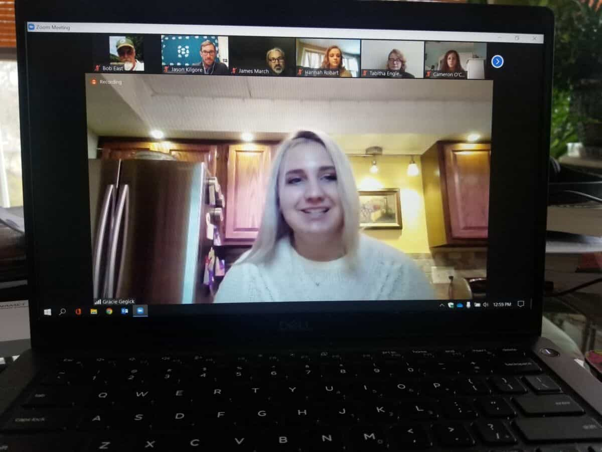 A computer displaying a zoom call during which five W&J College students presented their capstone experiences. Featured in the center is Gracie Gegick, one of the five student presenters.