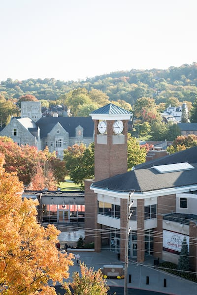 The clock tower at Rossin Campus Center as seen with the Technology Center in the background October 21, 2019 during the Creosote Affects photo shoot at Washington & Jefferson College.