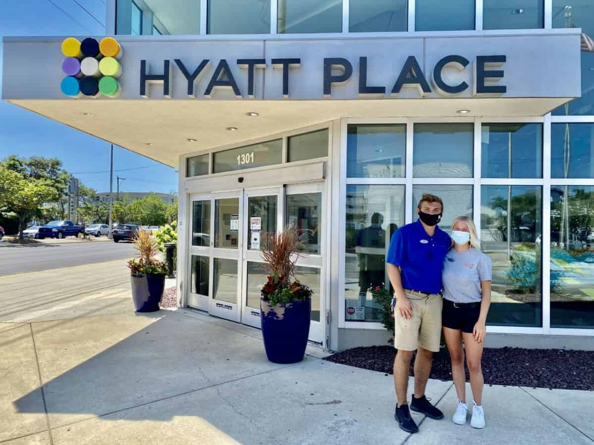 Colleen Kelley and Josh Burns pose outside of Hyatt Place in Dewey Beach, where they interned during the summer of 2020.