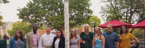 Students in the Interfaith Leadership Club Pose with a Peace Pole.