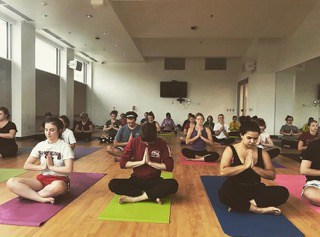 A group of students in a yoga class