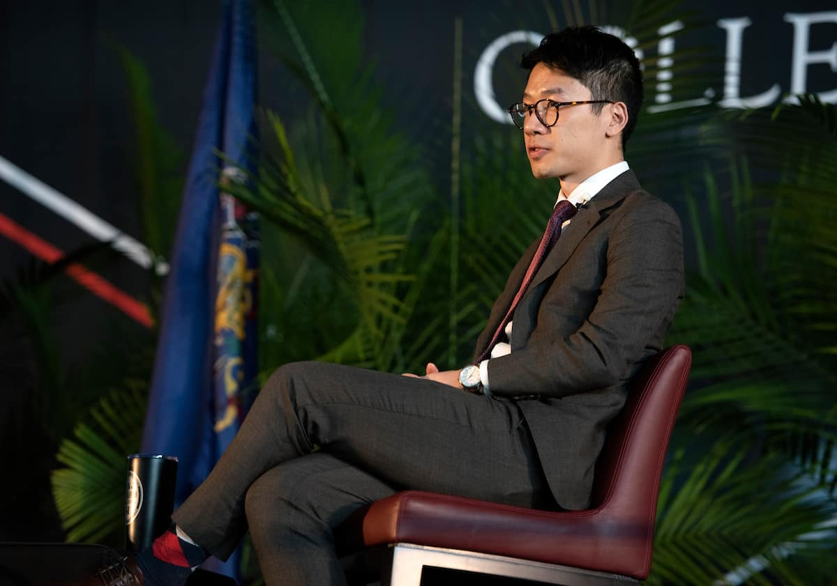 Nathan Law sits on stage at the 2020 Washington & Jefferson College Symposium on Democracy.
