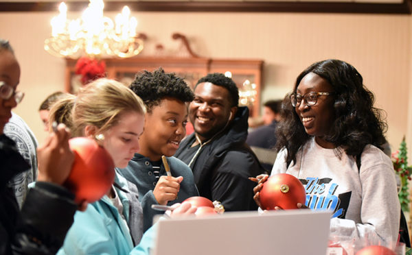 Students gather in the President's Dining Room on W&J's campus to sign ornaments.