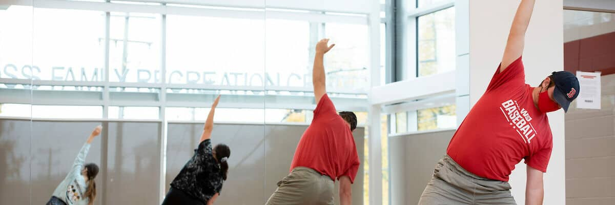 Patti Spadaro teaches yoga to both remote and in-person students October 26, 2020 in the James David Ross Family Recreation Center exercise room on the campus of Washington & Jefferson College.